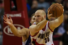 Photo Credit: TRIBUNE PHOTO: JAIME VALDEZ - Trail Blazers center Chris Kaman regains control of the ball against Los Angeles Clippers forward Blake Griffin during Sunday night's exhibition game at Moda Center. Portland won 119-114.