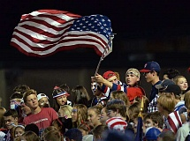 Photo Credit: REVIEW PHOTO: VERN UYETAKE - Through thick and thin, Cooper Cheetham kept the Stars and Stripes waving waving Friday night.
