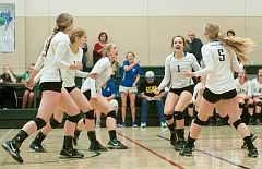 Photo Credit: LON AUSTIN/CENTRAL OREGONIAN - The Crook County High School volleyball team celebrates a point during the Cowgirls' victory over Southridge in pool play at the Clearwater Classic Volleyball Tournament in Bend. The Cowgirls tied for third in the tournament. In photo are, left to right, Karlee Hollis, Laura Fraser, Kayla Hamilton, Abby Smith and Meghan Wood. Also on the court, but hidden, is Aspen Christiansen. Head Coach Rosie Honl is in the center (standing) in the background.