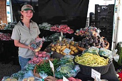 Photo Credit: PAMPLIN MEDIA GROUP PHOTOS: DAVID ASHTON  - Gabrielle Rossi sells potatoes she planted in May at Portlands Montavilla Farmers Market. On middle right, the harvest of Red Thumb potatoes begins. On right, Gabrielle checks out the old family tractor before the evenings potato dig.