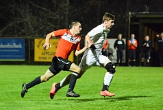 Photo Credit: JOHN WILLIAM HOWARD - Scappoose senior Asa Flanagan races an Astorian defender for the ball late in the match on Tuesday evening in Warrenton. Flanagan scored the equalizer in the 62nd minute, helping to pull Scappoose even before fellow senior Devin Timmons got the game-winner two minutes later.