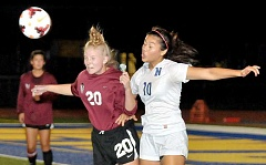 Photo Credit: SETH GORDON - Sophomore Isabela Vargas duels for a header with Tualatin's Maura Dunigan during Newberg's 2-1 loss to No. 1-ranked Tualatin Oct. 9 at Loren Douglas Field. The Tigers were level until an own-goal in the final minute helped the Timberwolves escape with a      victory.