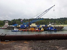 Photo Credit: SUBMITTED PHOTO - Steel pipes were welded into 240-foot lengths before being loaded onto a barge for a trip down the Willamette River.