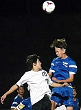 Photo Credit: DAN BROOD/TIGARD TIMES - On the rise - Tim Reeves gets airborn to field a header during Newberg's 1-1 draw at Tualatin Oct. 9. The Tigers (0-3-3) are still  searching for their first win in the new Three Rivers League.