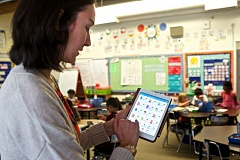 Photo Credit: TIMES PHOTO: JAIME VALDEZ - Marcy Godesa, a first-grade teacher at McKinley Elementary School, demonstrates how she uses the ClassDojo digital application in her classroom.