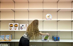Photo Credit: TIMES PHOTO: JONATHAN HOUSE - Learning Palace manager Sherri McBride pulls toys off the shelves at her Washington Square store, which closed this week. The store had only a few months to go on its 15 month lease.
