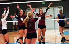 Photo Credit: DAN BROOD - WAY TO GO -- Sherwood High School volleyball players (from left) Maddy McSmith, Sarah Penner, Maddie Milner and Taylor Hubbard celebrate after scoring a first-set point against St. Mary's.