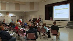 Photo Credit: MARK MILLER - St. Helens School District Superintendent Mark Davalos presents options for reopening the shuttered Columbia City School at a public forum Wednesday, Oct. 15, in the cafeteria of McBride Elementary School.