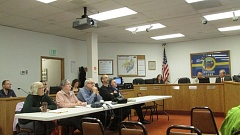 Photo Credit: MARK MILLER - Members of the St. Helens Planning Commission (foreground), St. Helens City Council (background) and City Planner Jacob Graichen (far left) at a joint meeting Wednesday, Oct. 15.