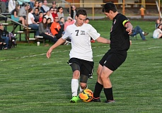 Photo Credit: JOHN WILLIAM HOWARD - Scappoose senior Devin Timmons pushes up field during the second half of the Indians' 4-0 victory over Tillamook. Timmons scored two early goals to get the offense rolling for the home side.
