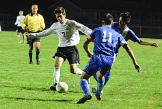 Photo Credit: JOHN WILLIAM HOWARD - St. Helens senior Dillon Gonzalez races to the ball during the second half of the Lions' 5-1 loss to No. 9 Hillsboro. Gonzalez scored the lone goal against the Spartans, sneaking behind the keeper in the second minute to put the Lions on top early.