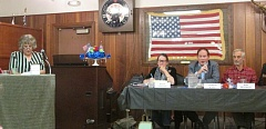 Photo Credit: COURTNEY VAUGHN - Alta Lynch, pictured at the left, moderates a candidates forum Tuesday evening at the Elks Lodge in St. Helens. Pictured to the right: District 16 State Senate candidates Betsy Johnson, Andrew Kaza and Bob Ekstrom