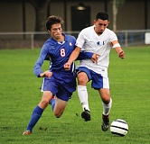 Photo Credit: HILLSBORO TRIBUNE PHOTO: AMANDA MILES - Hilhi senior Rene Carmolinga battles with La Salle's Sean Hamel for control of the ball during Tuesday's NWOC boys soccer match.