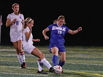 Photo Credit: HILLSBORO TRIBUNE PHOTO: CHASE ALLGOOD - Hilhi senior defender Anna Dean (19) and La Salle senior Veronica Horton converge on the ball during Tuesday's NWOC girls soccer match.