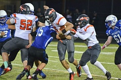 Photo Credit: JOHN BREWINGTON - Senior running back Johnny Tardif powers through a Valley Catholic tackle last week, part of a dominant offensive effort by the Indians to lead 49-0 at halftime.
