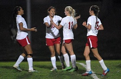 Photo Credit: THE OUTLOOK: DAVID BALL - Centennial rookie Rebecca Wheeler is greeted by teammates including Tara Phanakhone after scoring the nights only goal.