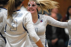 Photo Credit: PAMPLIN MEDIA: DAVID BALL - Madras setter Elle Renault celebrates after the White Buffalo scored a point in last weeks four-set win in Estacada.