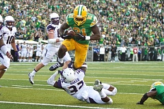 Photo Credit: TRIBUNE PHOTO: JAIME VALDEZ - Oregon Ducks running back Royce Freeman hurdles into the end zone for a first-half touchdown Saturday against the Washington Huskies.