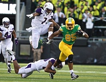 Photo Credit: TRIBUNE PHOTO: JAIME VALDEZ - Oregon Ducks tight end Pharaoh Brown eludes the Washington defense after hauling in a Marcus Mariota pass during Saturday's 45-20 UO victory at Autzen Stadium.