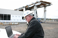 Photo Credit: JASON CHANEY - Dan Lewis, electrical inspector with Crook County Building Department, demonstrates how future inspections will be done by computer.