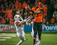 Photo Credit: COURTESY OF BETH BUGLIONE - Oregon State freshman Jordan Villamin (right) goes up for a pass against Utah.
