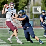 Photo Credit: SETH GORDON - Within grasp - Bruins defensive lineman Justin Kreuse harangues Puget Sound quarterback Braden Foley during the Logger's 33-14 win over George Fox Saturday. Kreuse collected one of GFU's five sacks on the day.