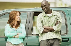 Photo Credit: SUBMITTED PHOTO - Open now - Carrie (Reese Witherspoon) talks with Jeremiah (Ger Duany), one of three refugee brothers, in 'The Good Lie.'
