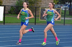 Photo Credit: TIMES PHOTO: MATT SINGLEDECKER - Aloha's Alexa Bailey, left, and Taylor Nickel, right, hope to take the Warriors to third place in Metro, which would clinch a team berth at the state meet.