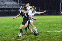 Photo Credit: JOHN WILLIAM HOWARD - St. Helens freshman Cora Beaudry (11) and Rex Putnam junior Lauren Gilbert battle for supremacy in the second half of the Lions' tilt with top-ranked Putnam on Tuesday evening.