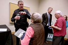 Photo Credit: TIMES PHOTO: JONATHAN HOUSE - Beaverton Police Chief Geoff Spalding and Oregon Rep. Tobias Read talk to voters during a Beaverton-sponsored Voters' Forum on Monday.