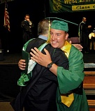 Photo Credit: TIDINGS FILE PHOTO: VERN UYETAKE - Jake Stoneking met a long-term goal when he received his diploma from West Linn High School with the class of 2014 on June 2.