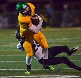 Photo Credit: VERN UYETAKE - West Linn's Cody Coppedge looks to shake a tackle after hauling in a pass in last week's game.
