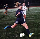 Photo Credit: DAN BROOD - Lake Oswego's Emma De Vine looks to pass the ball upfield during the Lakers' come-from-behind 2-2 tie with Tigard last week.