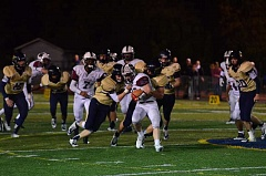 Photo Credit: HERALD PHOTO: COREY BUCHANAN - Canby players gang tackling a Sherwood player Friday night.