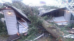 Photo Credit: PHOTO COURTESY OF KOIN LOCAL 6 - This tree crushed the garage in Lake Oswego, but no one was hurt during the High Wind Warning, Oct. 25, 2014