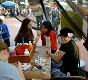 Canby High School students man the face painting booth during the recent Quality Education Festival in Portland.