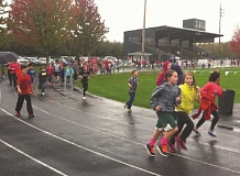 Photo Credit: SUBMITTED - Students race around the track at North Marion Intermediate School's jogathon Friday.