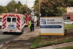 Photo Credit: DAVID F. ASHTON - An ambulance, fire rig, and the police come to the aid of a Mt. Scott Learning Center student struck by a vehicle on S.E. Holgate Boulevard.