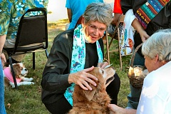Photo Credit: DAVID F. ASHTON - All Saints Episcopal Church Rector Rev. Laura Truby blesses Dinah at the annual pet blessing.