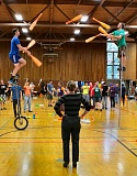 Photo Credit: DAVID F. ASHTON - Hailing from San Luis Obispo, California, is the juggling team called Something Ridiculous, whose members are passing clubs with Mark Wilder on a high unicycle - and Jonathan Nowaczyk, balancing on a ladder.