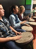 Photo Credit: CONTRIBUTED PHOTO - Oregon Trail Academy students are learning to play West African Rhythms on brand new drums.