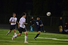 Photo Credit: HERALD PHOTO: COREY BUCHANAN - Esteban Zamora boots the ball during Canby's loss to Franklin Tuesday night.