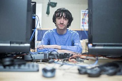 Photo Credit: TIMES PHOTO: JONATHAN HOUSE - Reza Fouladian, 17, has already secured a job as chief technology officer of an online company, thanks to the work of Tigard High Schools Information Technology program