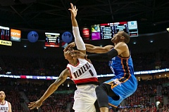 Portland's Damian Lillard gets a facial from Russell Westbrook on the Thunder guard's follow through.