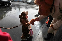 McGruff the Crime Dog hands candy to a young trick-or-treater during downtown Tigard's 'Trick or Treat Main Street' event, which returns on Oct. 31.