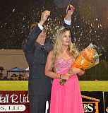 Photo Credit: JOHN BREWINGTON - Syrina Revis is showered with glitter after being crowned as homecoming queen at Scappoose High School on Friday, Oct. 17.