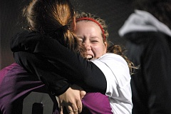 Photo Credit: THE OUTLOOK: DAVID BALL - Corbett High forward Josie Fort embraces goalie Kendall Sheerman after the Cardinals closed out a 1-0 win over Stayton in the fourth round of a penalty kick shootout Saturday night.