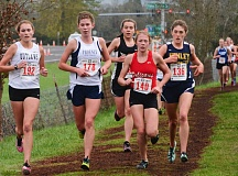 Photo Credit: JOHN WILLIAM HOWARD - Scappoose freshman Linnaea Kavulich (center, in black) keeps up with the pack of leaders through a third of the OSAA Class 4A finals in Eugene.
