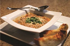Photo Credit: DAN PRED - Lentil soup with Italian sausage, accompanied by cheesy French bread, is perfect on a cold evening.