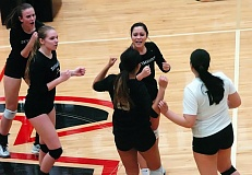Photo Credit: TIMES PHOTO: DAN BROOD - Southridge's Nica Loo and the Southridge volleyball team celebrate a point during their sweep over Tualatin.